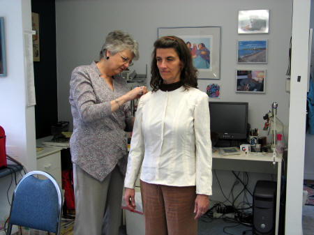 Fitting the muslin for a couture jacket.